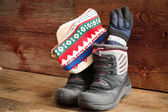 Childs snow boots with a winter cap and gloves — Stock Photo