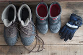 Adult and kids snow boots with gloves — Stock Photo