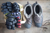 Snow boots and a bag of winter gloves and mittens — Stock Photo