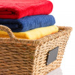 Fresh clean towels in a wicker basket — Stock Photo