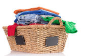 Clean washed fresh clothing in a wicker basket — Stock Photo