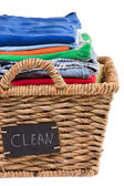 Washed fresh clean clothes in a laundry basket — Stock Photo