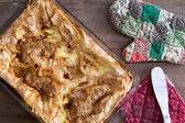 Uncut Turkish borek fresh from the oven — Stock Photo