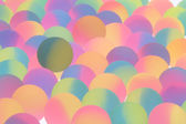 Festive bicolor plastic balls background — Stock Photo