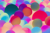 Illuminated bicolor balls background — Stock Photo