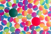 Colorful background of bicolor plastic balls — Stock Photo