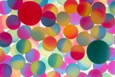 Colorful abstract of bicolour plastic balls — Stock Photo