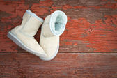 Warm winter sheepskin slippers — Stock Photo