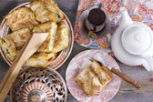 Delicious picnic eats with borek and Turkish tea — Stock Photo