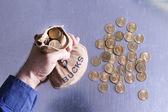 мужчина держит деньги, мешок баксов — Стоковое фото