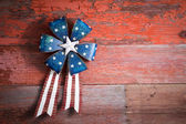 4th July patriotic badge on rustic wood — Stock Photo