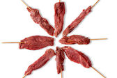 Arrangement of lean tender uncooked beef kebabs — Stock Photo