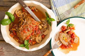 Sliced meatloaf in a casserole on a rustic table with copy space — Stock Photo