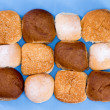Variety of hamburger buns isolated on blue — Stock Photo #47271079