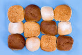 Variety of hamburger buns isolated on blue — Stock Photo