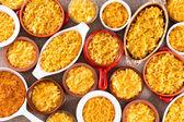 Cheese macaroni served conceptually on table cloth — Stock Photo