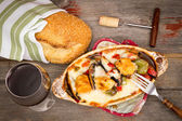 Chicken and vegetable stew with bread and wine — Stock Photo