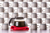 Full carafe of coffee with stacked clean cups — Stock Photo