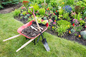 Garden work being done landscaping a flowerbed — Stock Photo