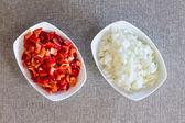 Prepared diced fresh onions and tomato — Stock Photo