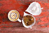 Chocolate caramel latte with walnut crisp bread — Stock Photo