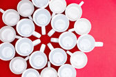 Coffee and tea cups in a flower pattern — Stock Photo
