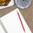 Open notebook with nut cookies and a gift — Stock Photo #48426457