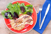 Grilled food served with salad — Stock Photo