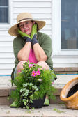 Attractive senior woman potting up plants — Stock Photo