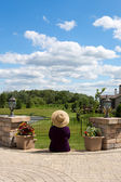 Grandma gardener taking a break to admire the view — Stock Photo