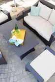 Upmarket outdoor patio with garden furniture — Stock Photo