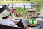 Elegant senior lady relaxing on her patio — Stock Photo