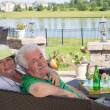 Elderly couple enjoy a relaxing day on the patio — Stock Photo