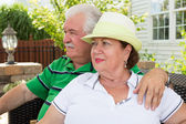 Elderly couple sitting gazing into the distance — Stock Photo