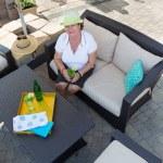 Stylish senior woman drinking on a patio — Stock Photo #49911519