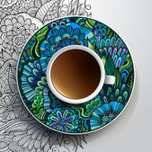 Cup of coffee and hand drawn floral ornament on a saucer — Stock Vector