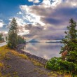 Road in Yellowstone and Rays of Light over the lake — Stock Photo