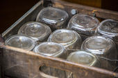 Old fashon jars in a wooden box — Stock Photo