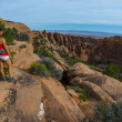 Female hiker stading on a Devils Garden trail — Stock Photo #51622359