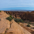 Female hiker on a Devils Garden trail to Double O Arch  — Stock Photo #51622365