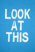 Look at this - attention seeking graffiti. — Stock Photo