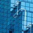 Abstract view of office block windows with blue tinted glass - Stock Photo