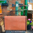 Old suitcase on vintage weighing scales — Stock Photo