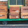 Stock Photo: Vintage suitcases and trolley