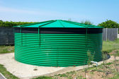 Cylindrical water storage tank. — Стоковое фото