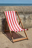 Red and white striped deckchairs — Stock Photo