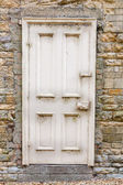 Old external door in a stone wall — Stock Photo