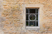 Old window set in limstone building — Stock Photo