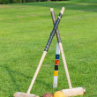 Croquet equipment propped up ready for use — Stock Photo