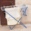 Outside clothes drier left in the street — Stock Photo